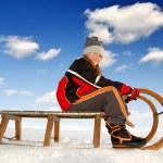 Girl on a sleigh — Stock Photo