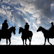 Cowboys with horses — Stock Photo