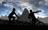Cyclists in sunset — Stock Photo