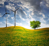 Spring landscape with wind turbine — Stock Photo