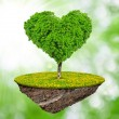 Little island and tree in the shape heart — Stock Photo