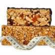 Chocolate Muesli Bars with measuring tape - Stock Photo