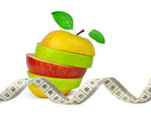 Apple mix with measuring tape — Stock Photo