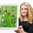 Girls holding a tablet computer - Stock Photo
