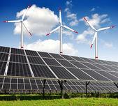 Solar energy panels and wind turbine — Stock Photo