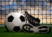 Soccer ball and shoes — Stock Photo