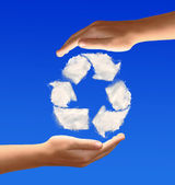 Recycle sign from clouds — Stock Photo
