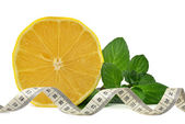 Lemons with measuring tape — Foto Stock