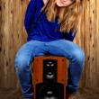 The girl sitting on the speaker - Stock Photo