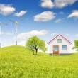 House in spring landscape - Stock Photo