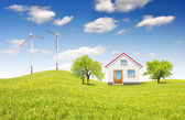 House in spring landscape — Stock Photo