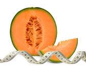Cantaloupe melon with measuring tape — Stock Photo