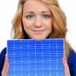 Girl holding in hands solar panel — Stock Photo