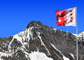 Taschhorn with Wallis flag — Stock Photo