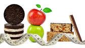 Chocolate Muesli Bars with apple and measuring tape — Stock Photo