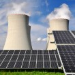 Solar energy panels before a nuclear power plant — Stock Photo