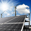 Foto Stock: Solar energy panels and wind turbines
