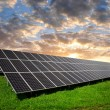 Solar energy panel in the setting sun — Stock Photo