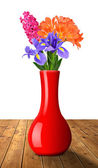 Flowers in red vase isolated on white — Stock Photo