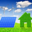 Green grass house symbol with solar panel and wind turbines — Stok fotoğraf