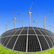 Foto Stock: Solar energy panels and wind turbine