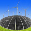 图库照片: Solar energy panels and wind turbine