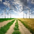 Field way with wind turbines — Stock Photo