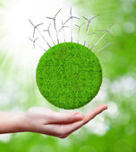 Grüner planet mit windkraftanlagen — Stockfoto