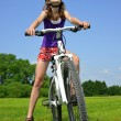Girl with bike — Stock Photo #29568061