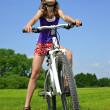 Girl with bike — Stock Photo