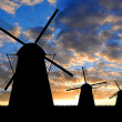 Silhouettes of windmills — Stock Photo