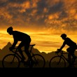 Silhouette of the cyclists — Stock Photo