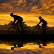 Silhouette of the cyclists — Stock Photo #31984543