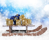 Christmas gifts in a sleigh — Stock Photo