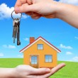 The house with key in the hands — Stock Photo