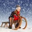 Girl on a sleigh — Foto de Stock