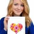 Girl holding tablet with heart — Lizenzfreies Foto