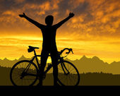 Silhouette of the cyclist on road bike — Stock Photo