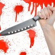 Stock Photo: Hand with knife