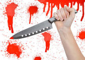Hand with knife — Stock Photo