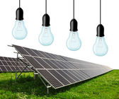Solar energy panels with bulbs — Stock Photo
