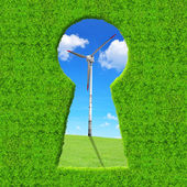 Green keyhole. On the background wind turbine — Stock Photo
