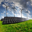 Solar energy panels with wind turbines — Stock Photo