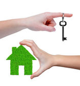 Green house with key in hands — Foto Stock