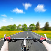 Rider driving bicycle — Stockfoto