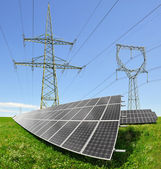 Solar energy panels with electricity pylon — Stock Photo