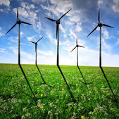 Wind turbines on meadow — Stok fotoğraf