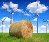 Straw bale with wind turbines — Stock Photo