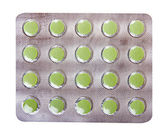 The green pills in a transparent package — Stock Photo