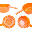 Set of four orange plastic strainers — Stock Photo